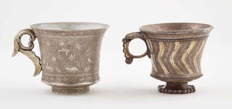 Two footed cup with ring handle