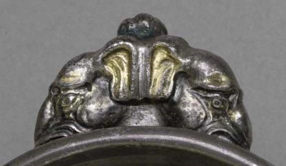 Thumb rest of a cup with elephants