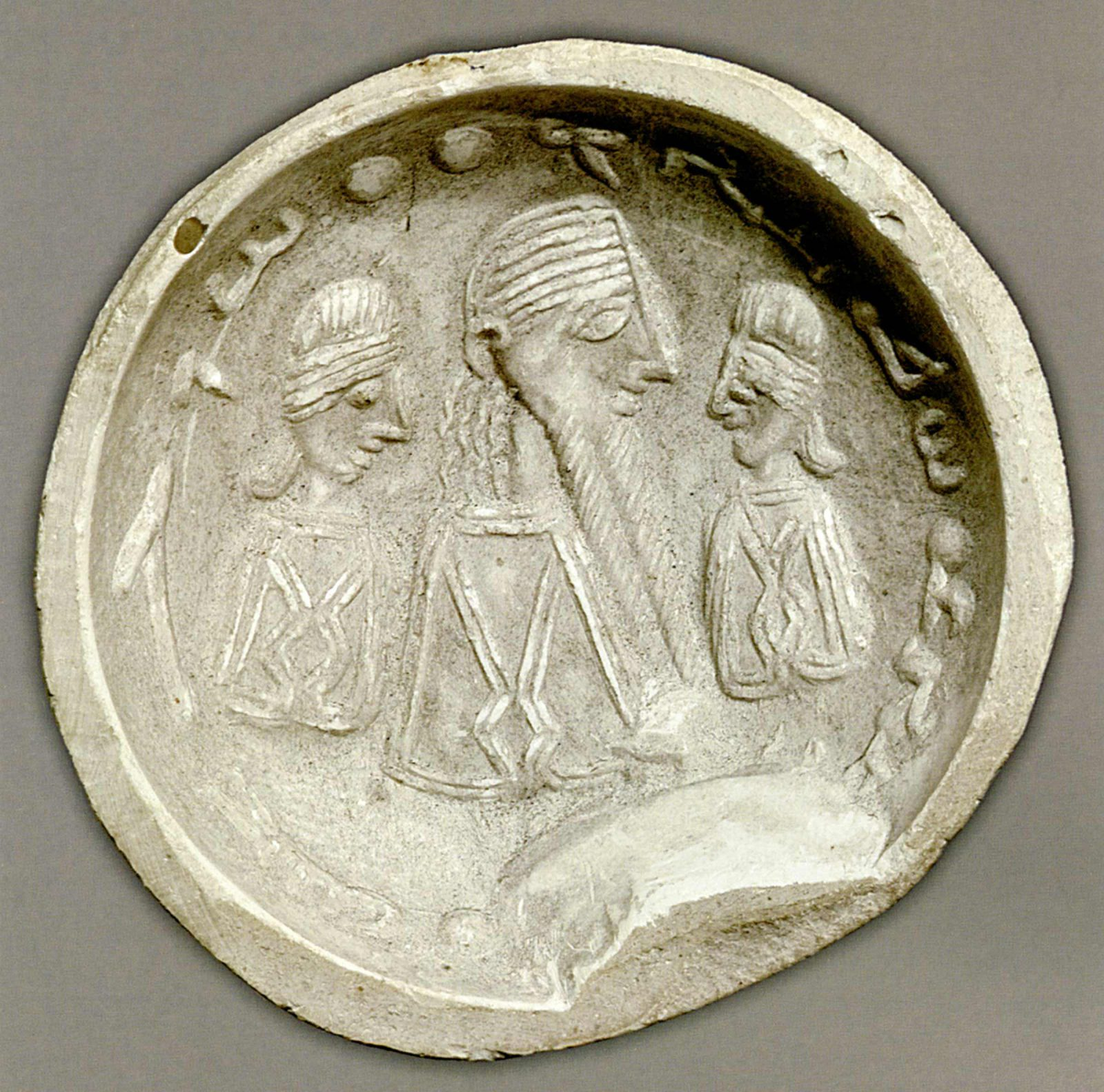 Three figures in profile under an inscription in circular impression of seal