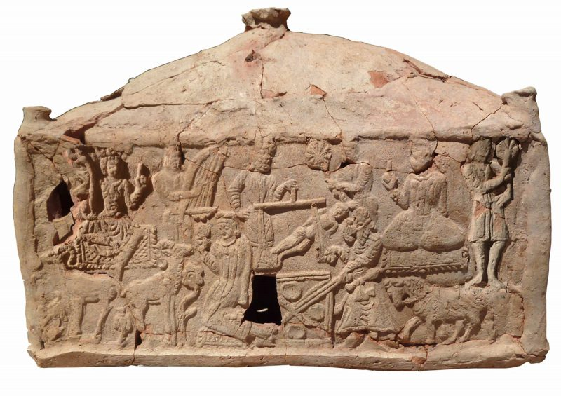 Side of the rectangular base of the container with several figures and animals