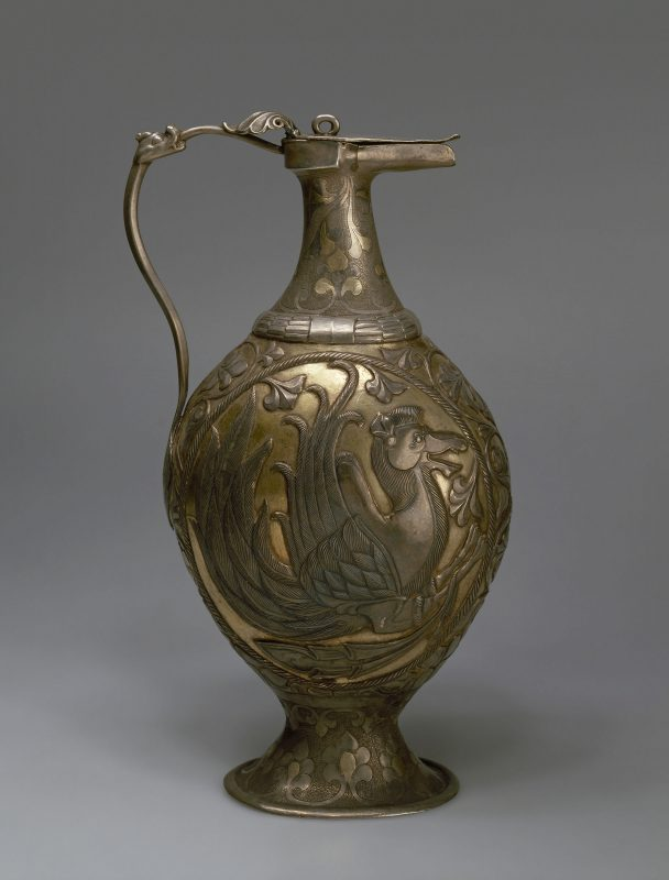 Ewer with thin handle, bulbous body and wide foot