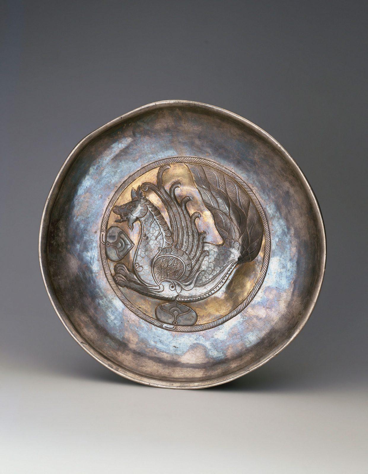 Plain shallow bowl with elaborate central design of a Senmurv
