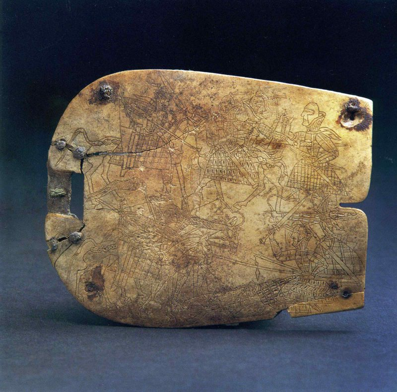 Square bone plaque with lightly incised battle scene