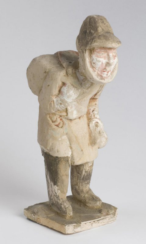 Slumped figure with conical hat and hunched back