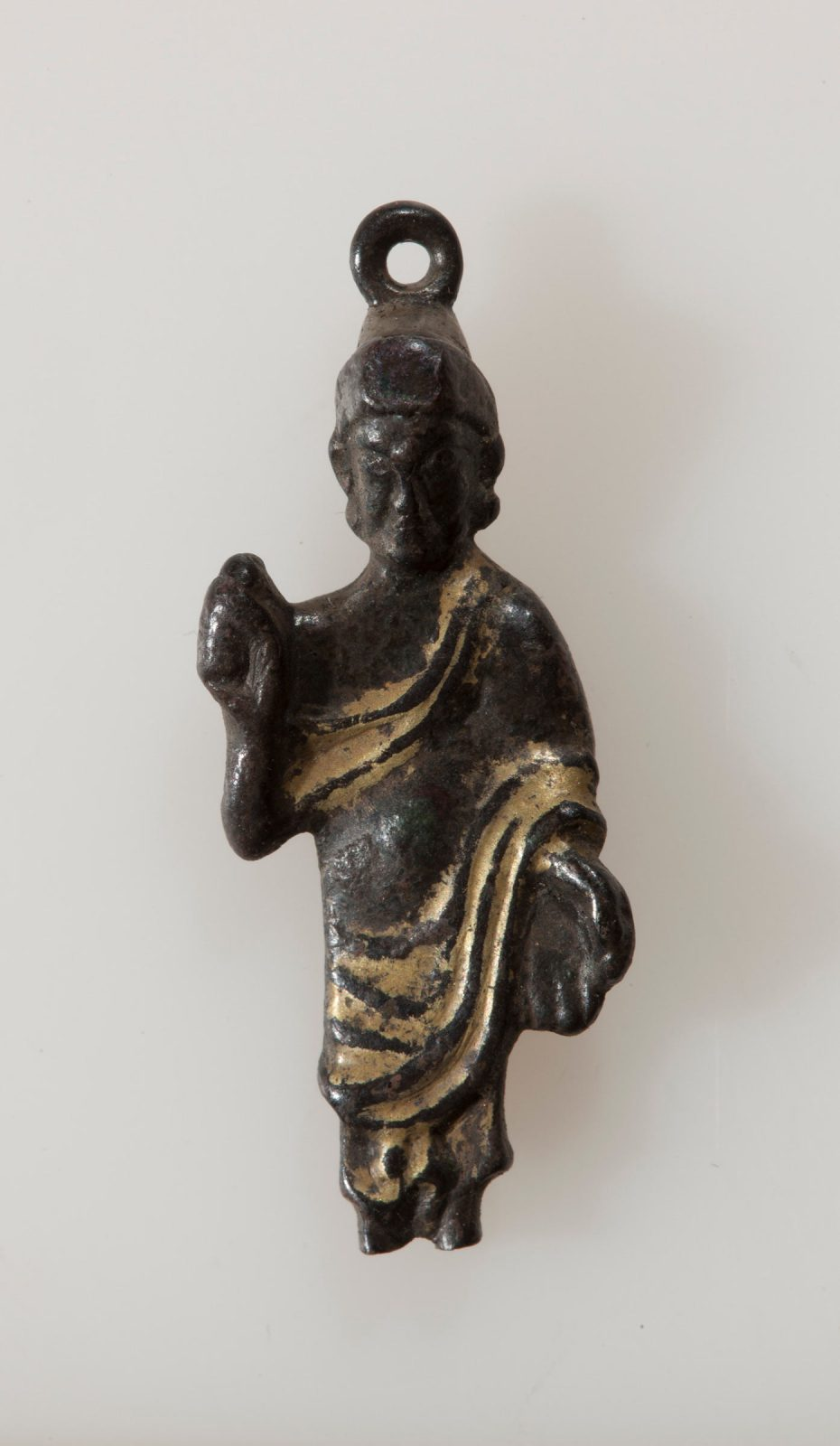Buddha figure with raised right hand and lowered left hand in robe