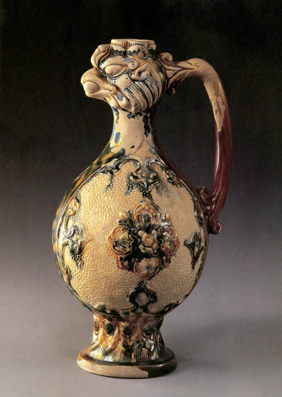 Ewer with bulbous body and bird face opening