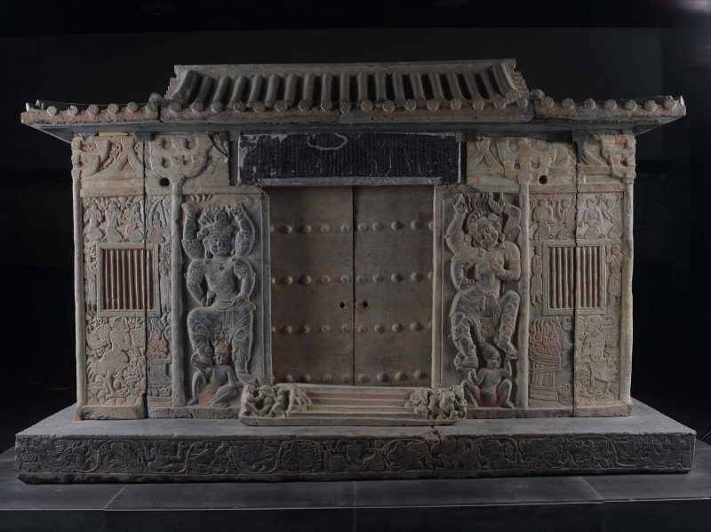 Front and entrance of the sarcophagus richly carved scenes