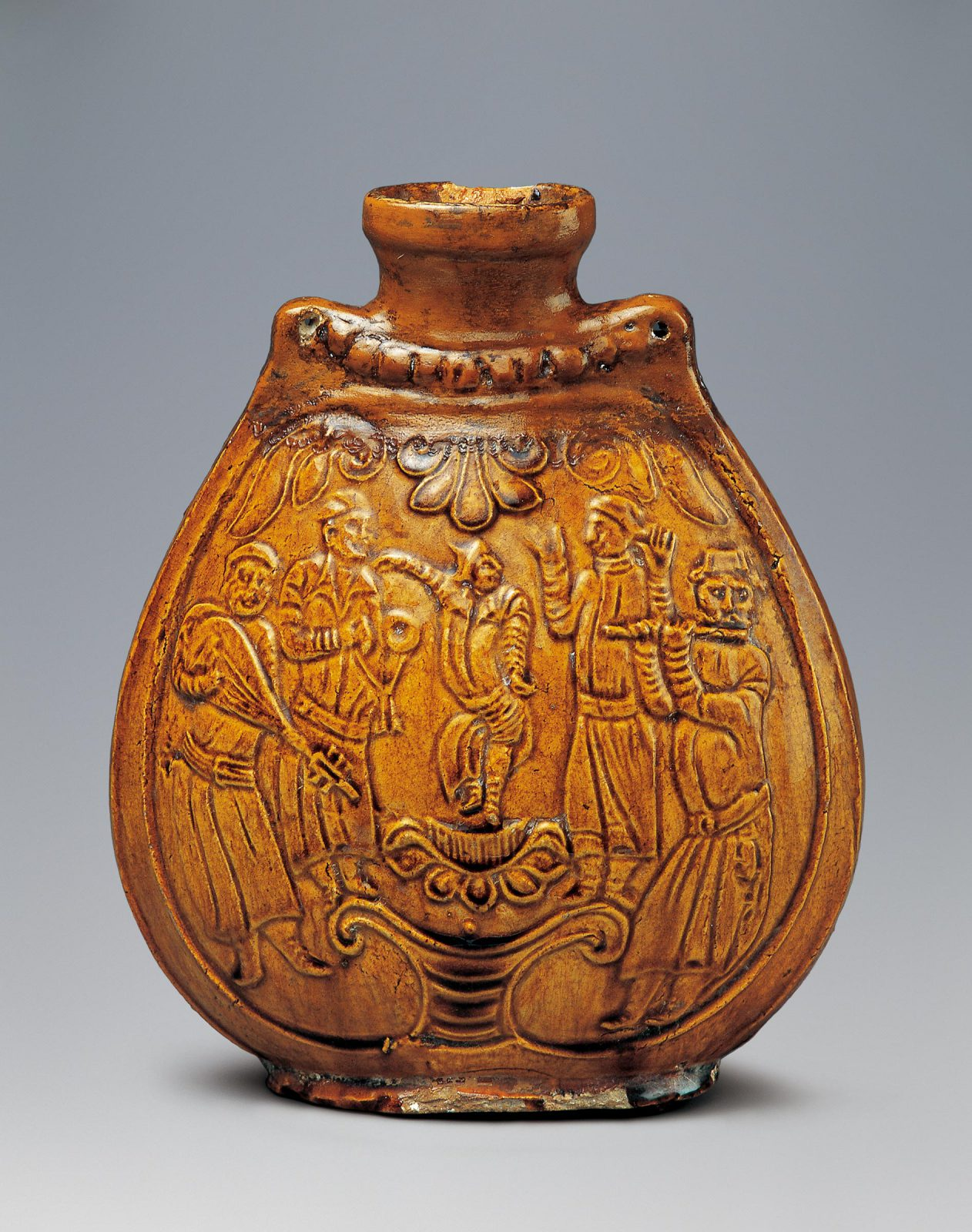 Flask with wide base and depiction of musicians
