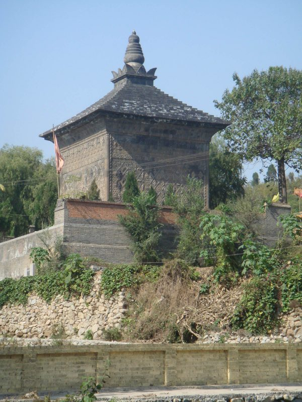 Cube pagoda with a triangular roof covered with ceramic tiles