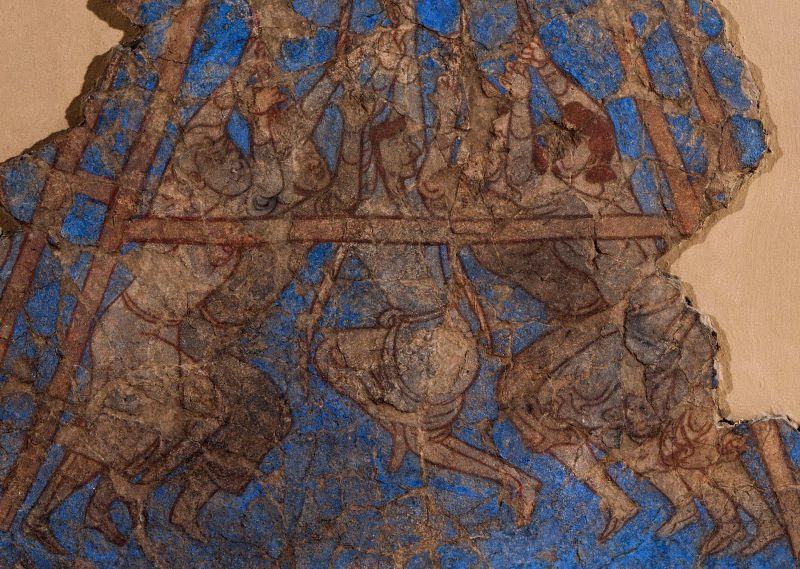 fragment of wall painting showing five men operating a siege machine