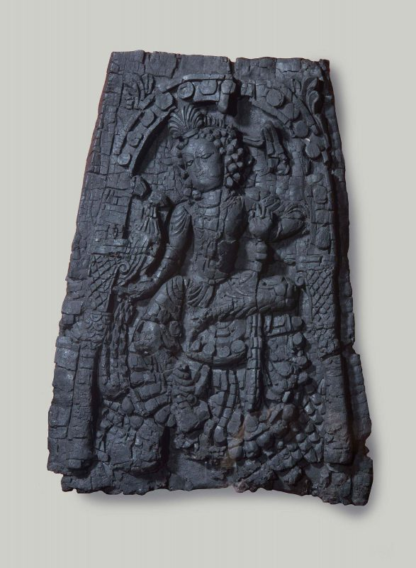 Panel showing a female deity and a peacock under an arch