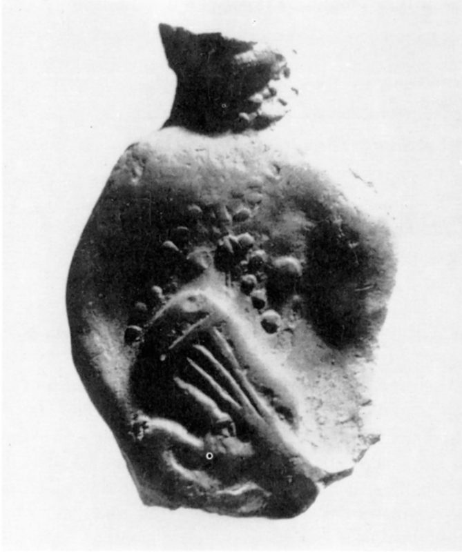 damage statue of figure playing a Lute