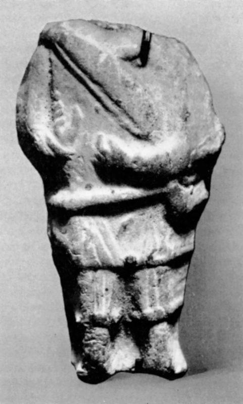 Headless figure holding an angular harp
