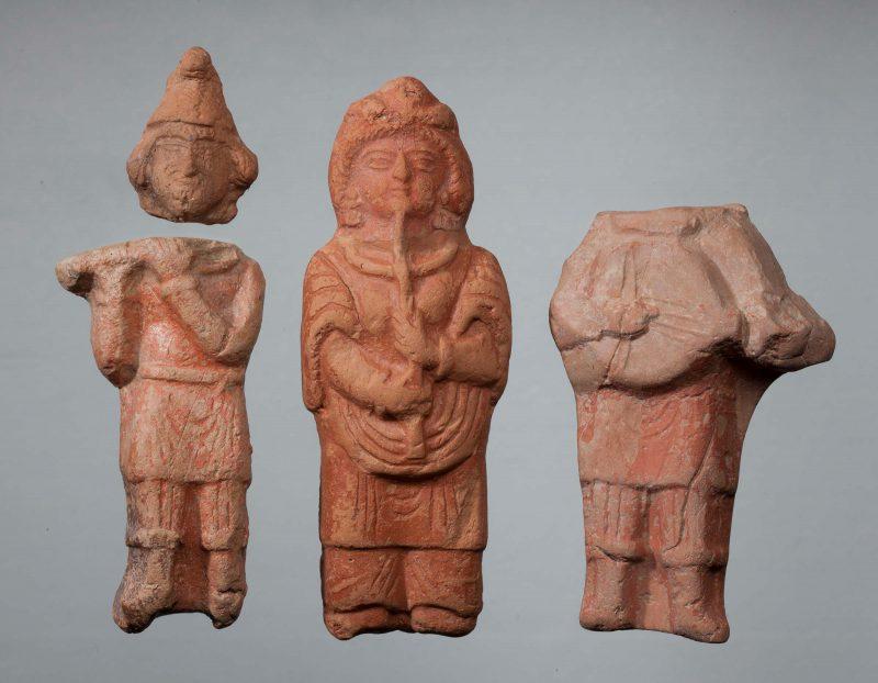 Three figurines of musicians