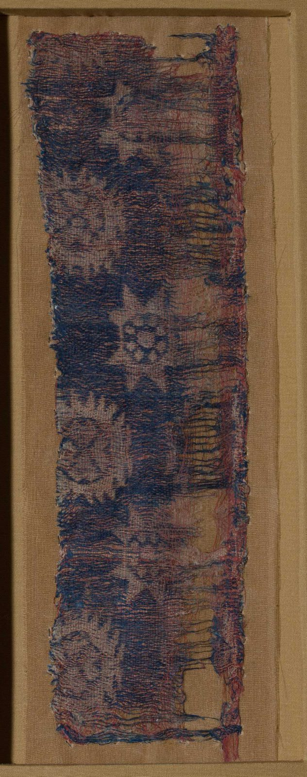 damaged textile with roundels