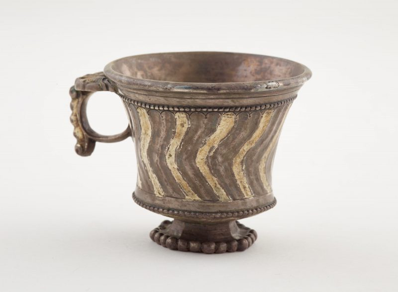 Footed cup with ring handle