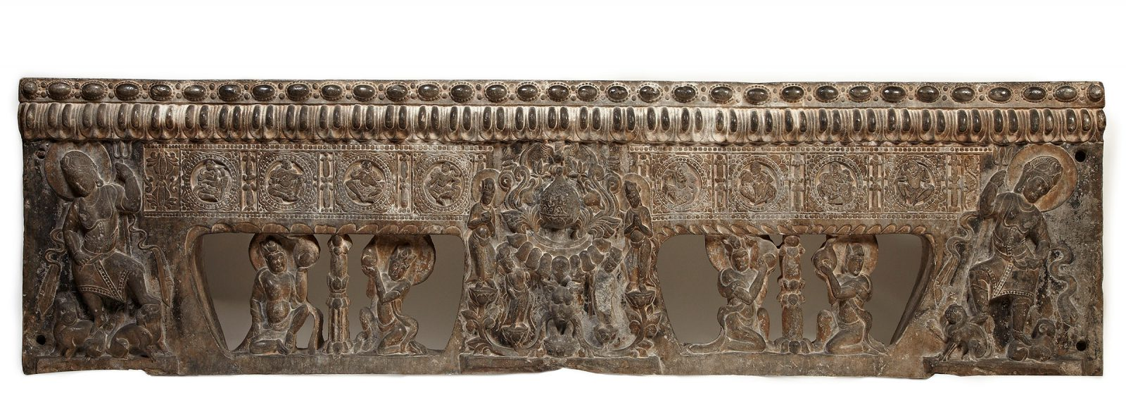 This richly carved font support of a Funerary Bed from Anyang shows figures with halos as well as representations of musicians.