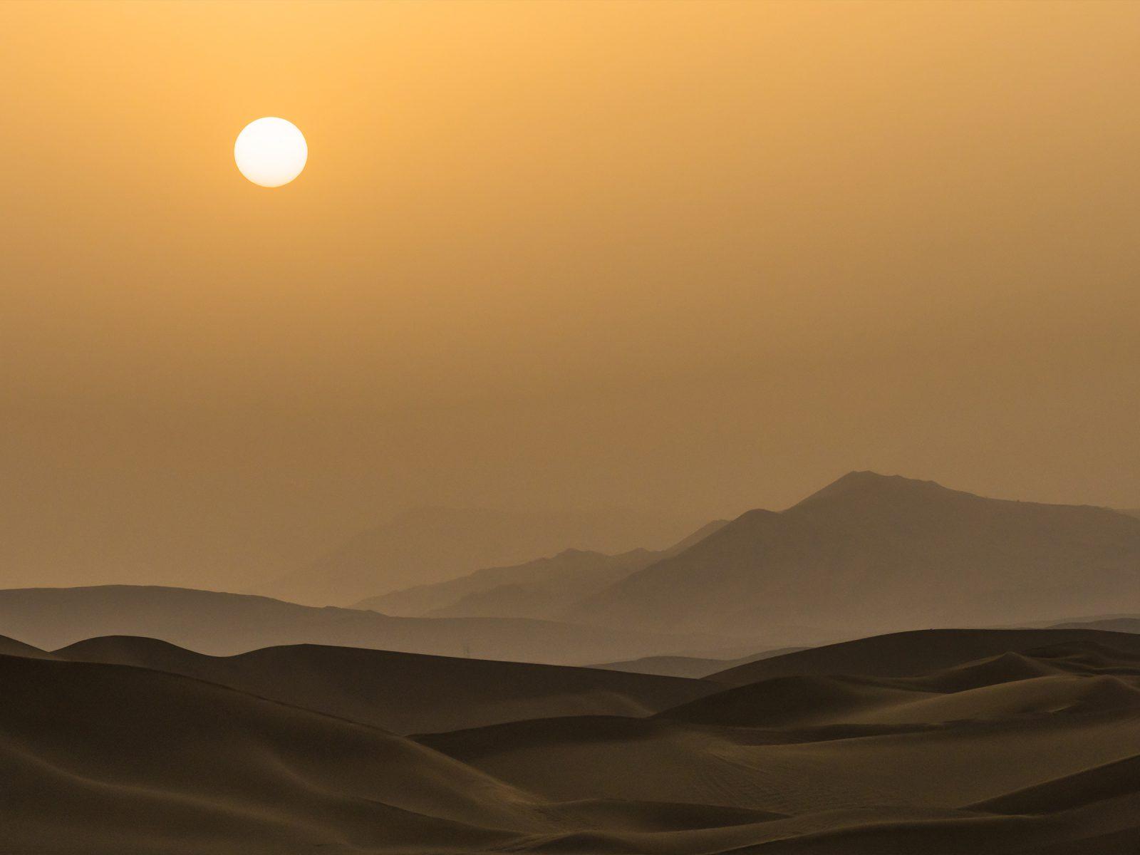 Silhouette of sunset on the desert in Xinjiang Uygur Autonomous Region, China. Photograph © iStock.com/Centuryboy.