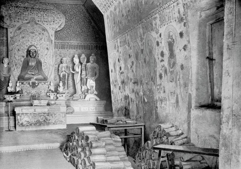 This composite photograph shows Cave 16 in Dunhuang, with its painted walls, large Buddhist sculpture and rolls of hundreds of Sogdian writings.