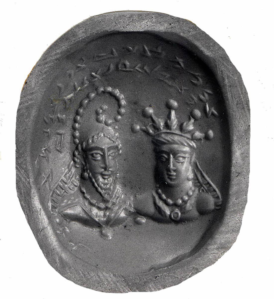 oval seal impression with two crowned figures under inscription