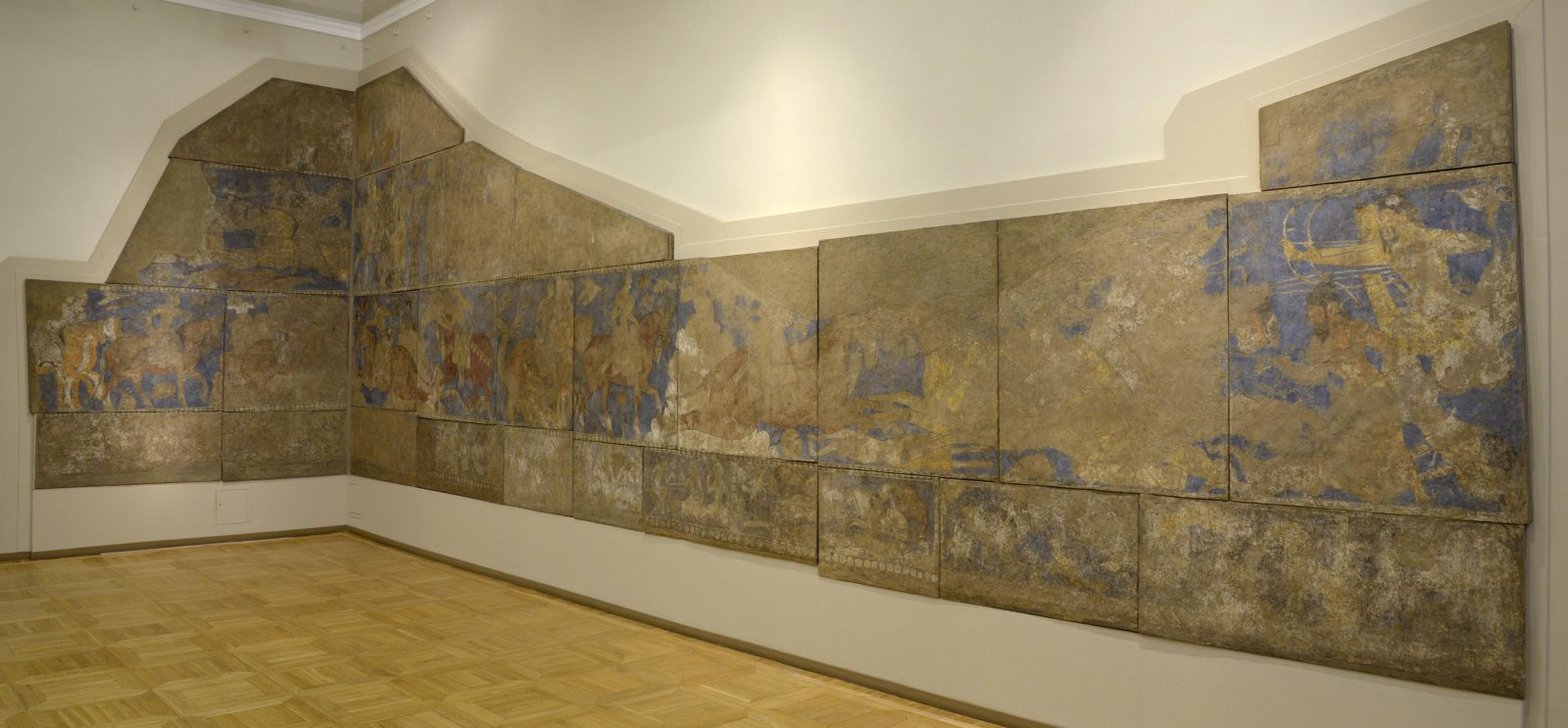 A series of paintings shows the story of the legendary hero, Rustam, This image shows how the paintings are preserved in the Hermitage museum today.