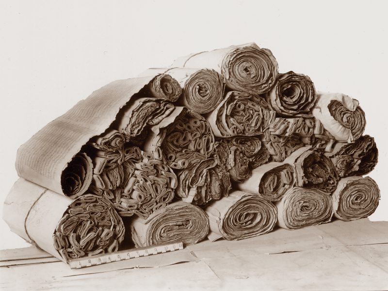 Hundreds of rolled scrolls in Sogdian were found in Dunhuang. This image shows a few stacked on top of each other.