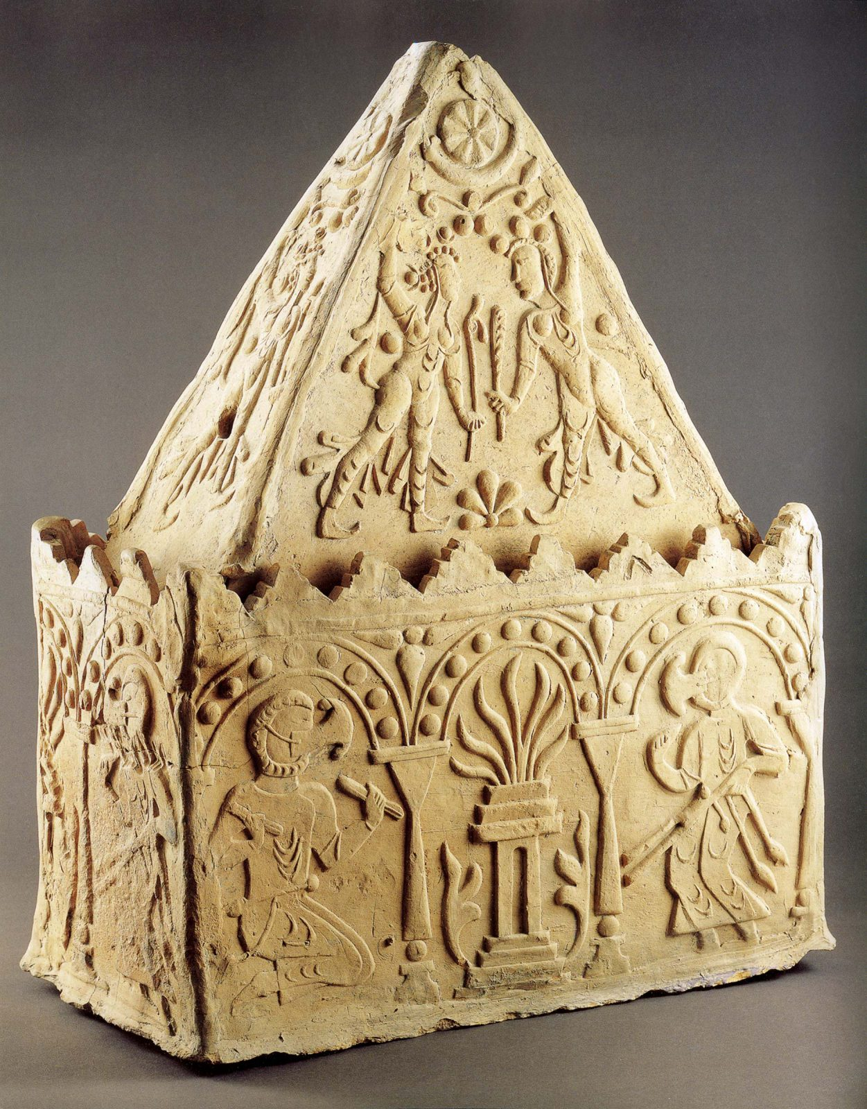Rectangular container with triangular lid decorated with priestly figures and divine ones