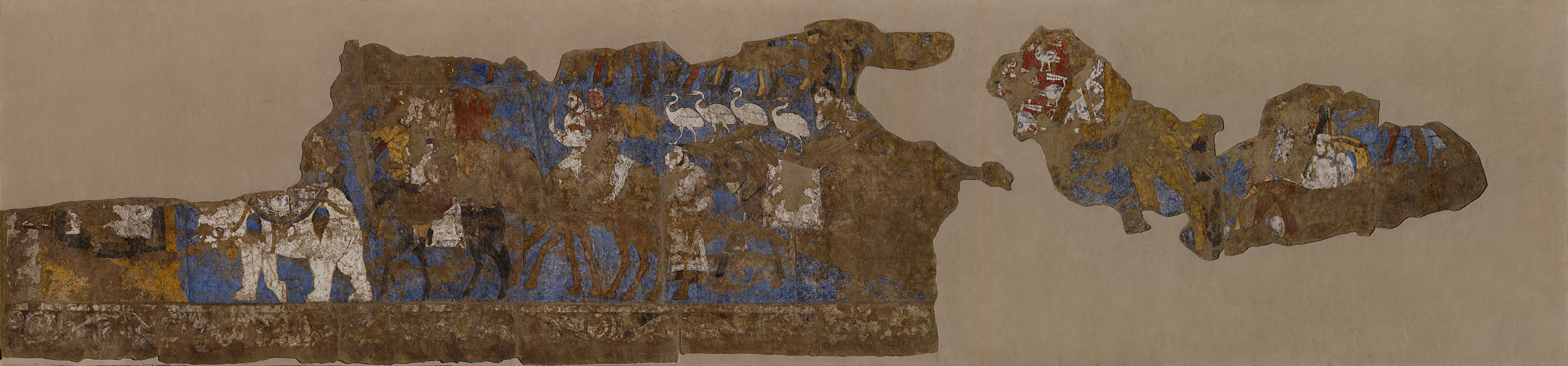 On the Southern Wall of the Hall of Ambassadors at Afrasiab, the wall paintings depict a procession of people seemingly from different parts of the world as indicated by their dress and animals bearing gifts.