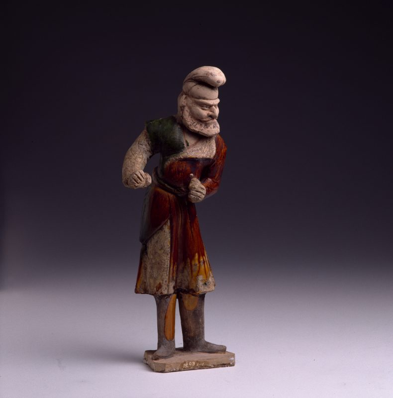 sculpture of man with beard and pointed hat