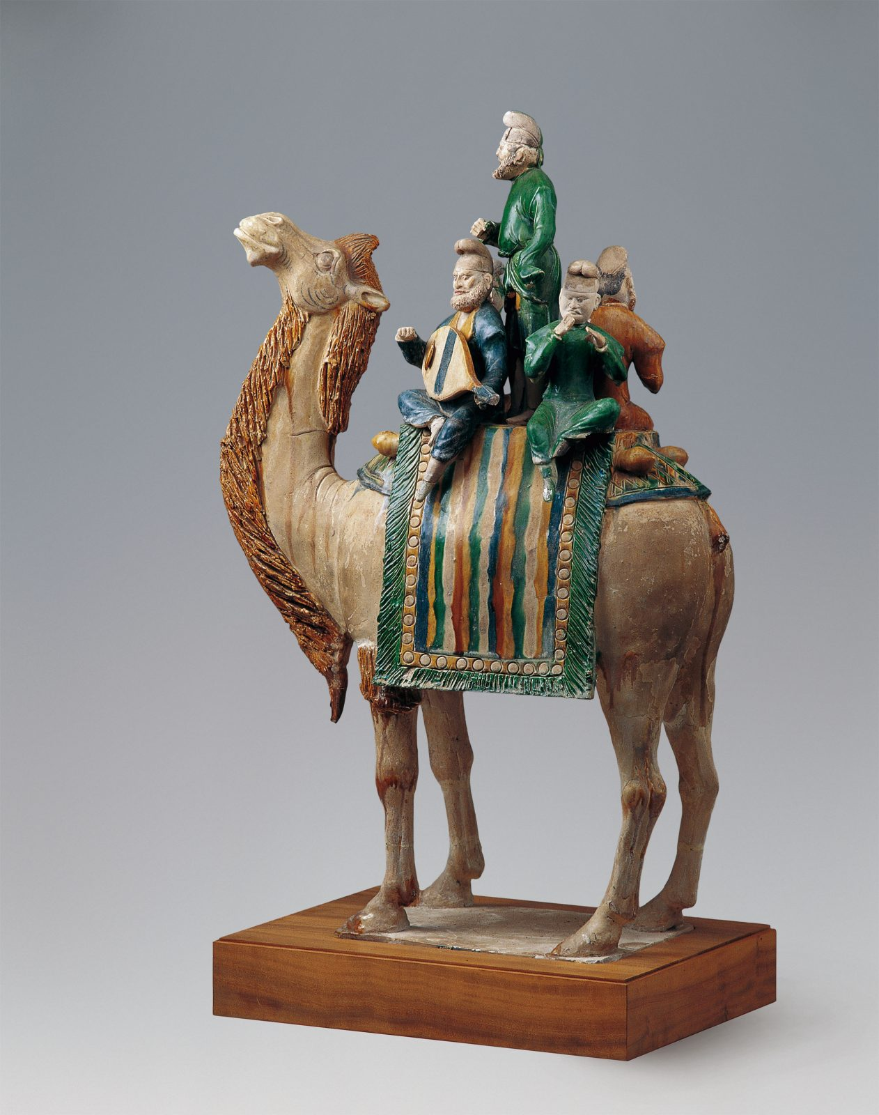 Several musicians on a camel